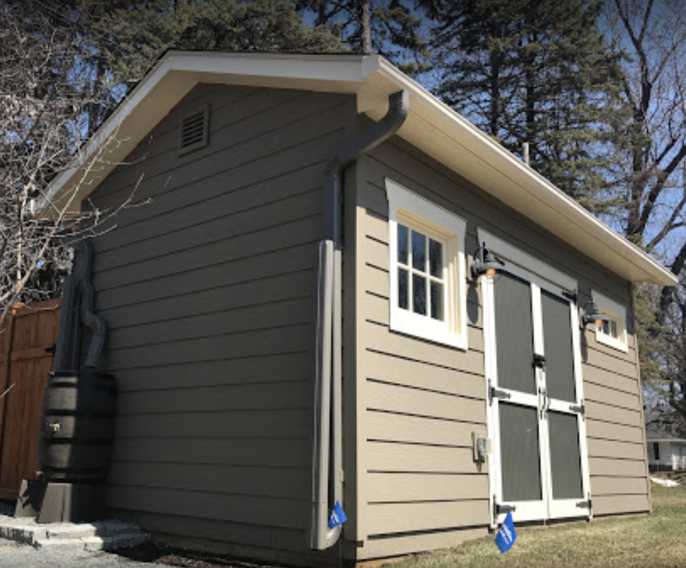 leaf guard gutter system with hinged downspouts on wisconsin shed